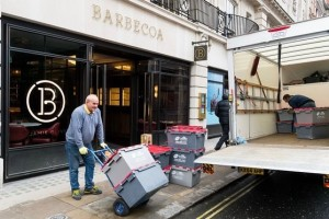 Removal men take away stock from Jamie Oliver's Barbecoa restaurant in Piccadilly, London. Photograph- Ray Tang-Rex-Shutterstock