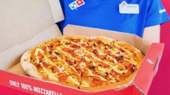 UK Domino's Pizza feud with franchises leads to 'Avoid' share advice