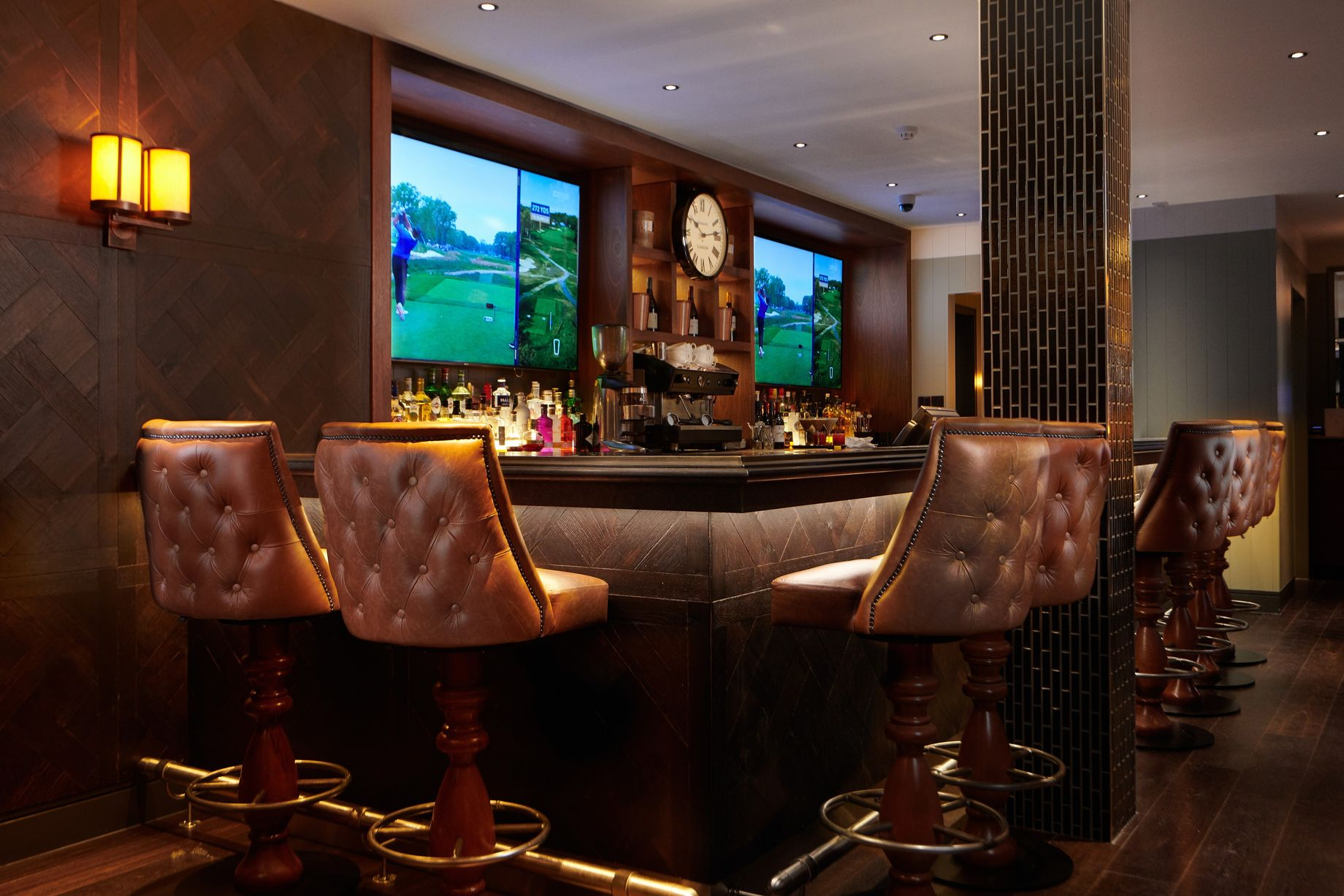 Luxurious seats around the bar at the Cameron House Clubhouse