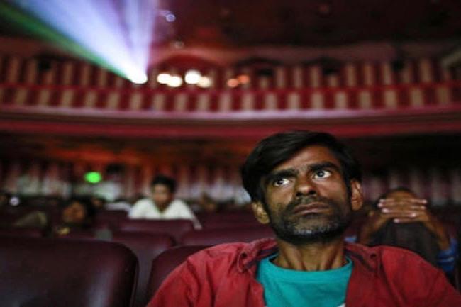 Indian man in cinema auditorium