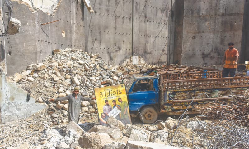 Poster for Bollywood blockbuster lies in the rubble of the Prince Cinema, Karachi. Photo by Fahim Siddiqi--White Star