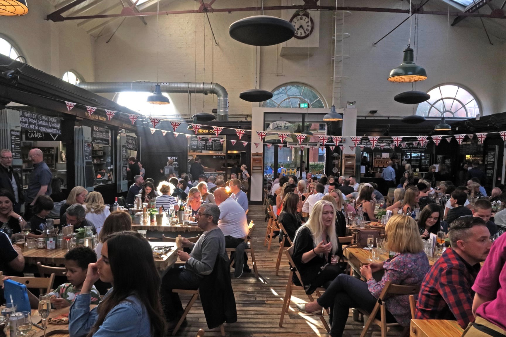 Trafford council partnered with a private investor to turn Altrincham's listed market hall into a trendy dining space. Photograph: Tony Smith/Alamy Stock Photo