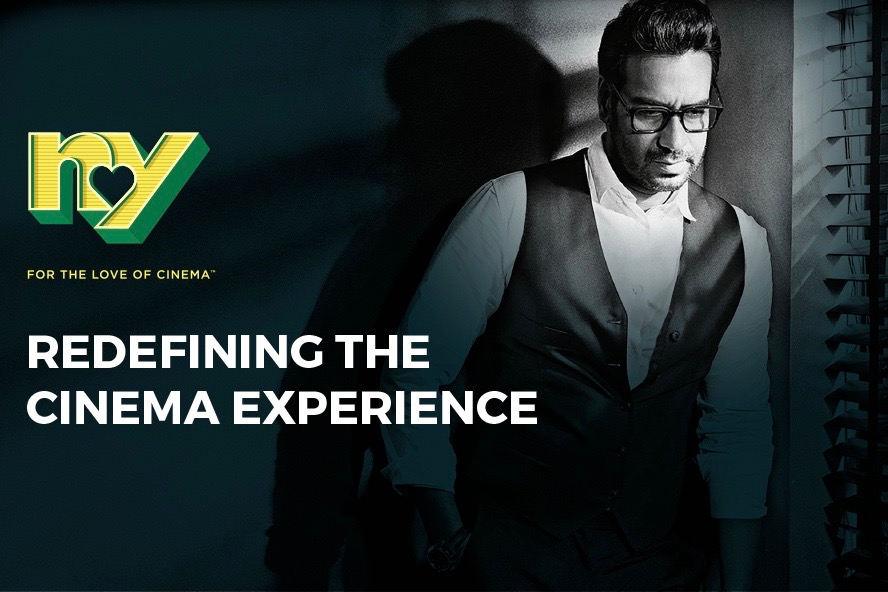 "Promotion for Ajay Devgn's NY Cinemas, ""redefining the cinema experience""."