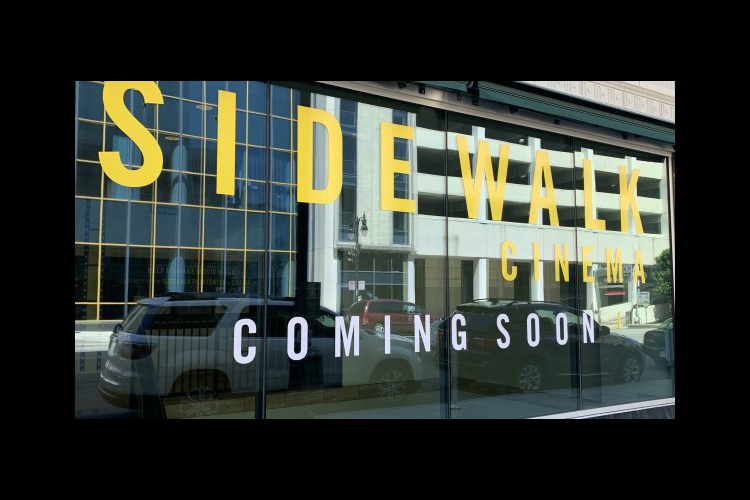 Sidewalk Cinema 'coming soon' sign