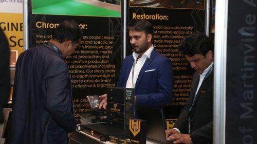 A visitor inquiring about products at Cinema Build KSA 2020 exhibition in Riyadh. (AN Photo/Yazeed Alsamrani)