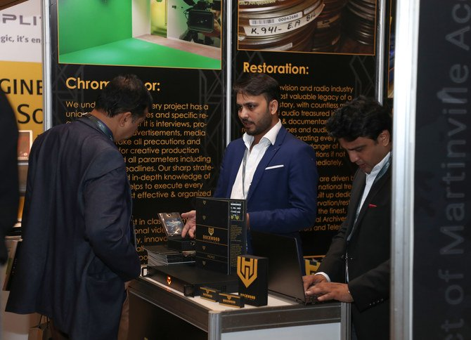 A visitor inquiring about products at Cinema Build KSA 2020 exhibition in Riyadh. (AN Photo/Yazeed Alsamrani)