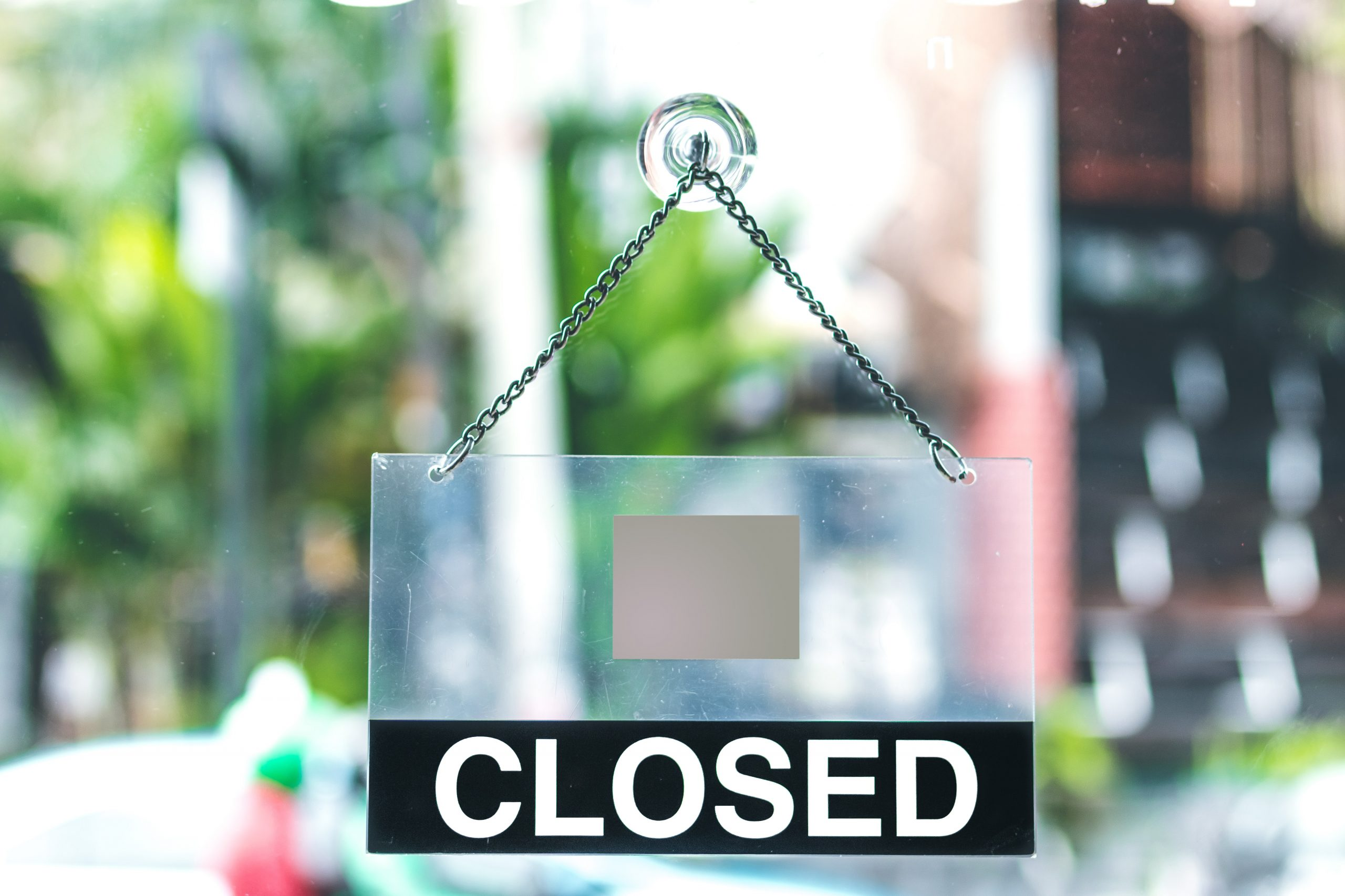 Closed sign on frosted glass door: Photo by Artem Beliaikin on Unsplash
