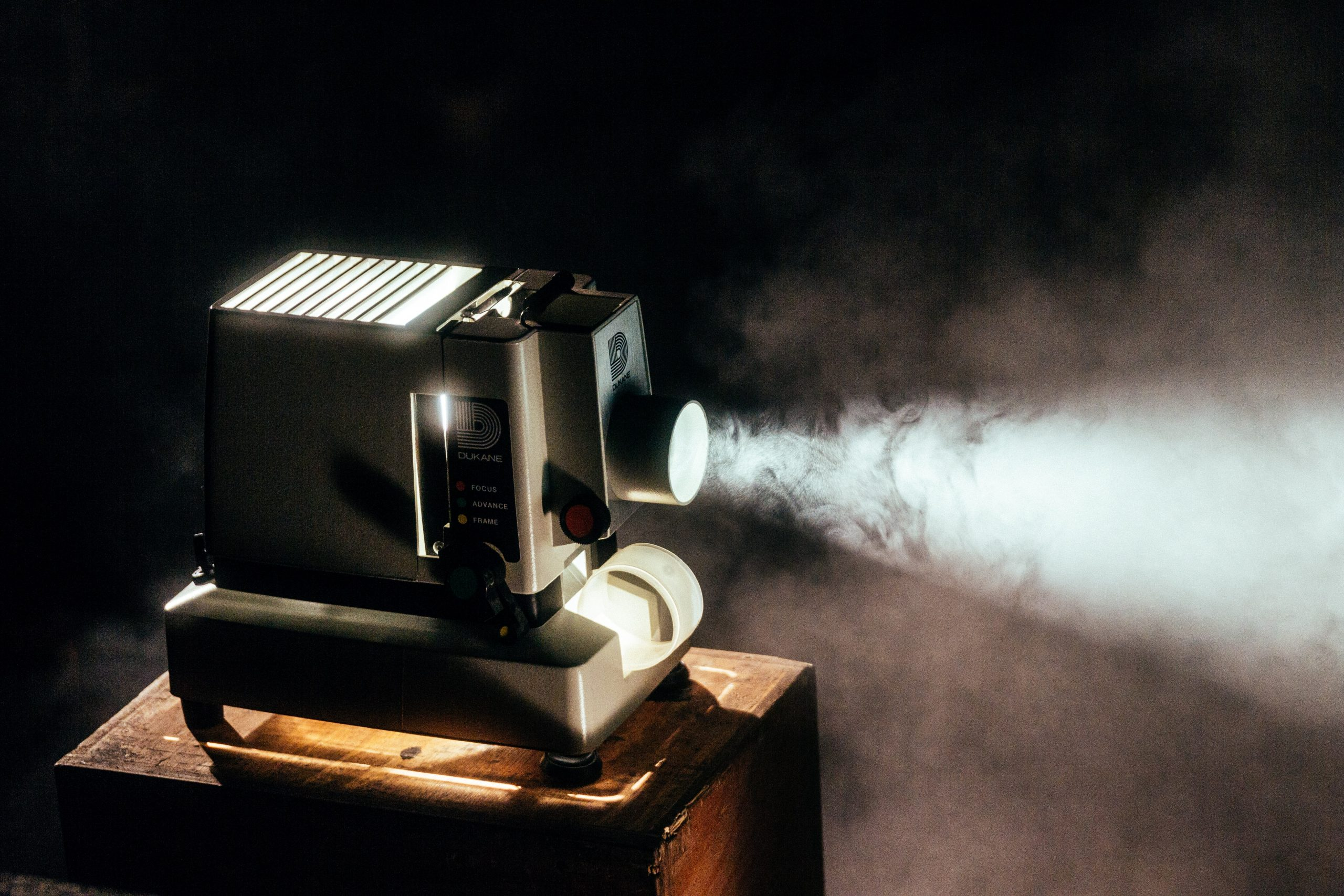 projector in smoky room. Photo by Jermy Yap/Unsplash