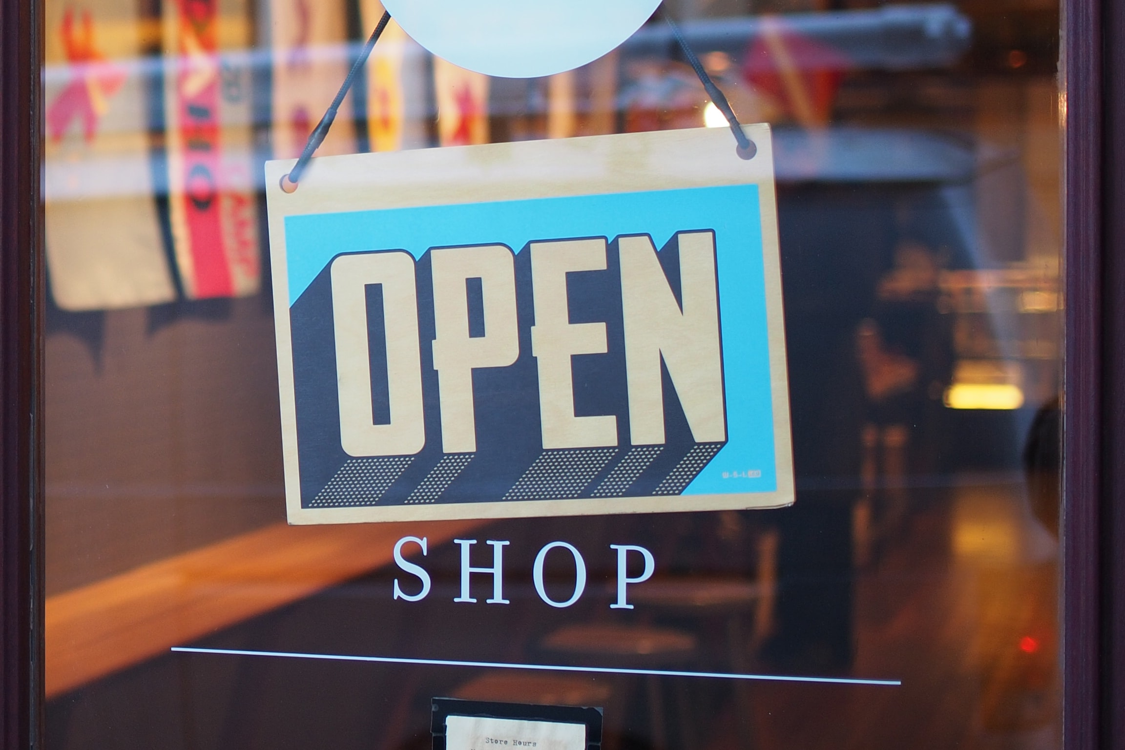 Shop open sign. Photo by Mike Petrucci on Unsplash