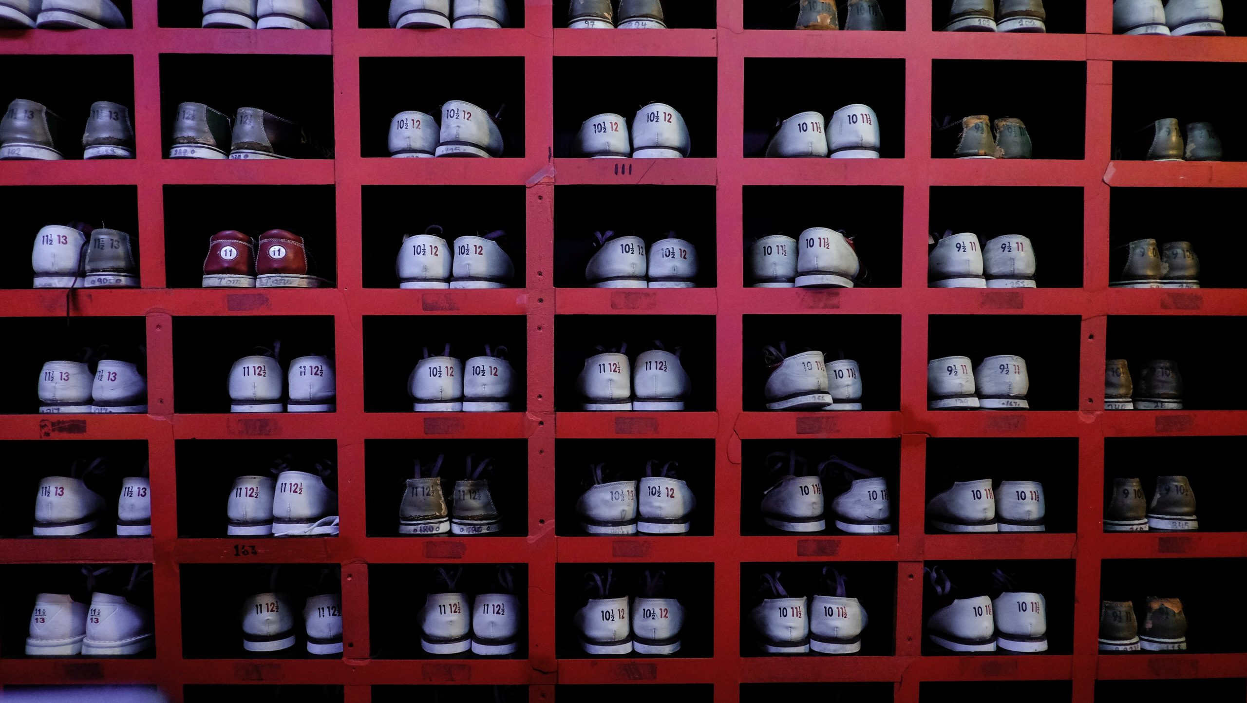 Bowling shoes, NYC. Photo by Alev Takil on Unsplash