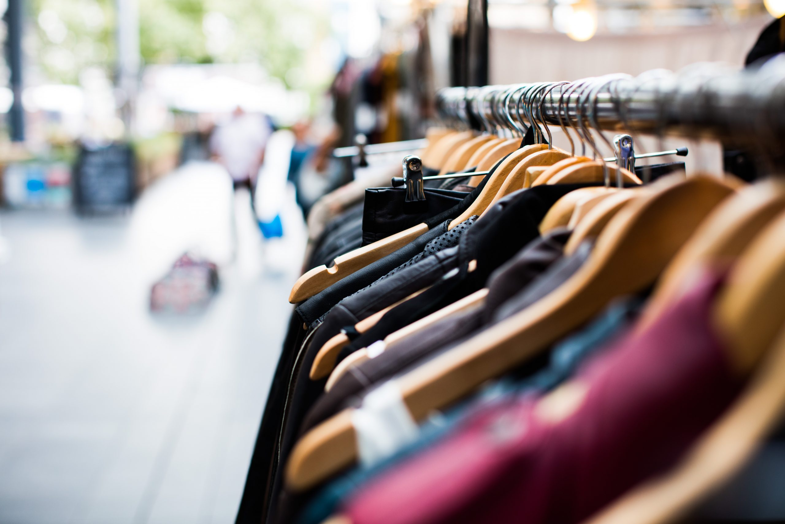 Clothes rail in modern store. Photo by Artificial Photography on Unsplash