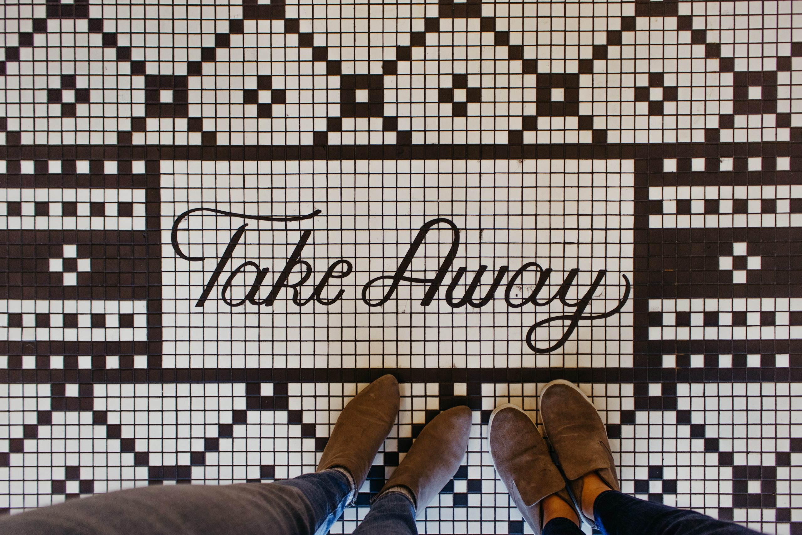 'Take Away' mosaic floor. Photo by Briana Tozour on Unsplash