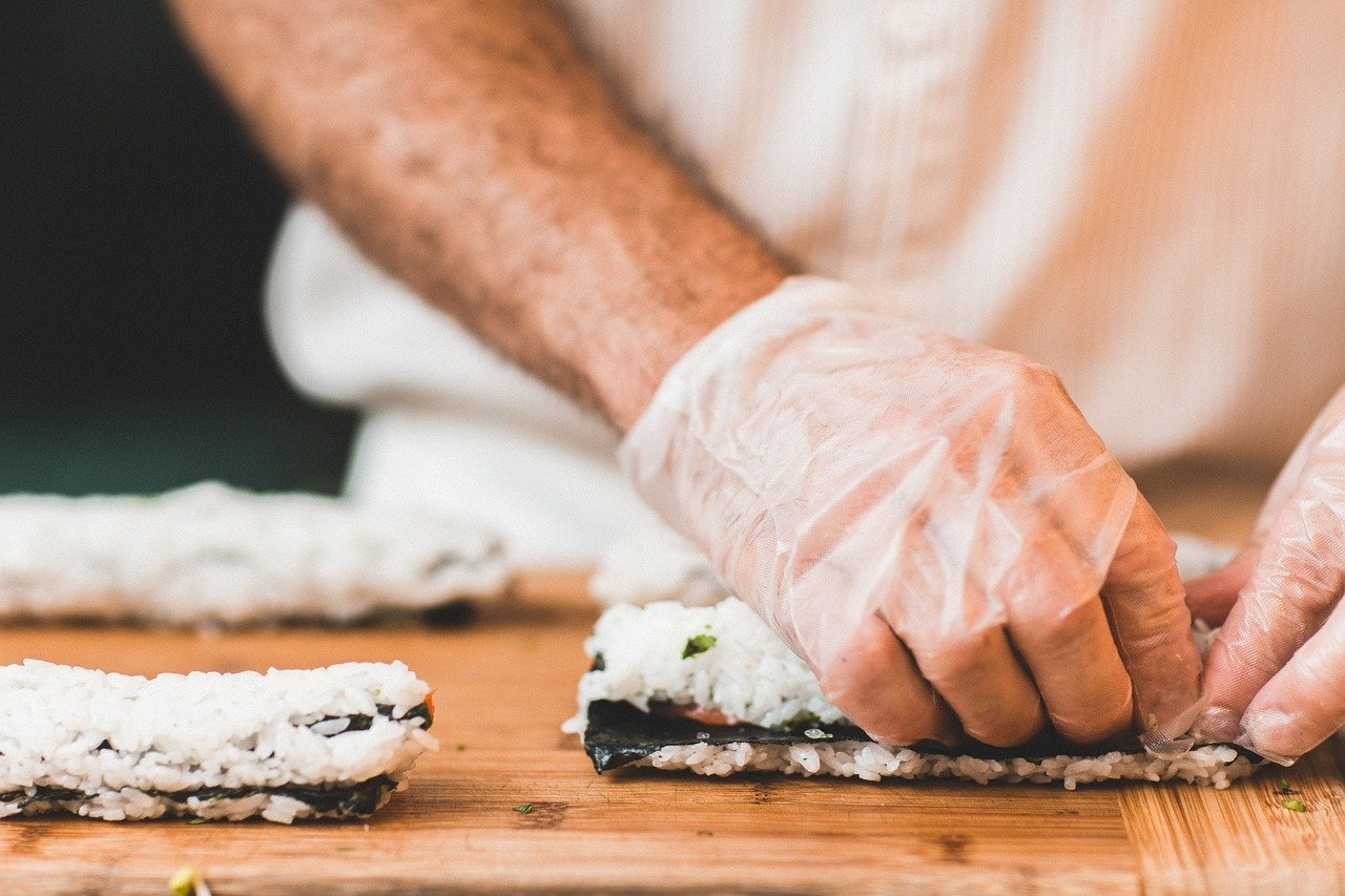 Sushi chef with surgical gloves. Image by Image by Free-Photos at Pixabay
