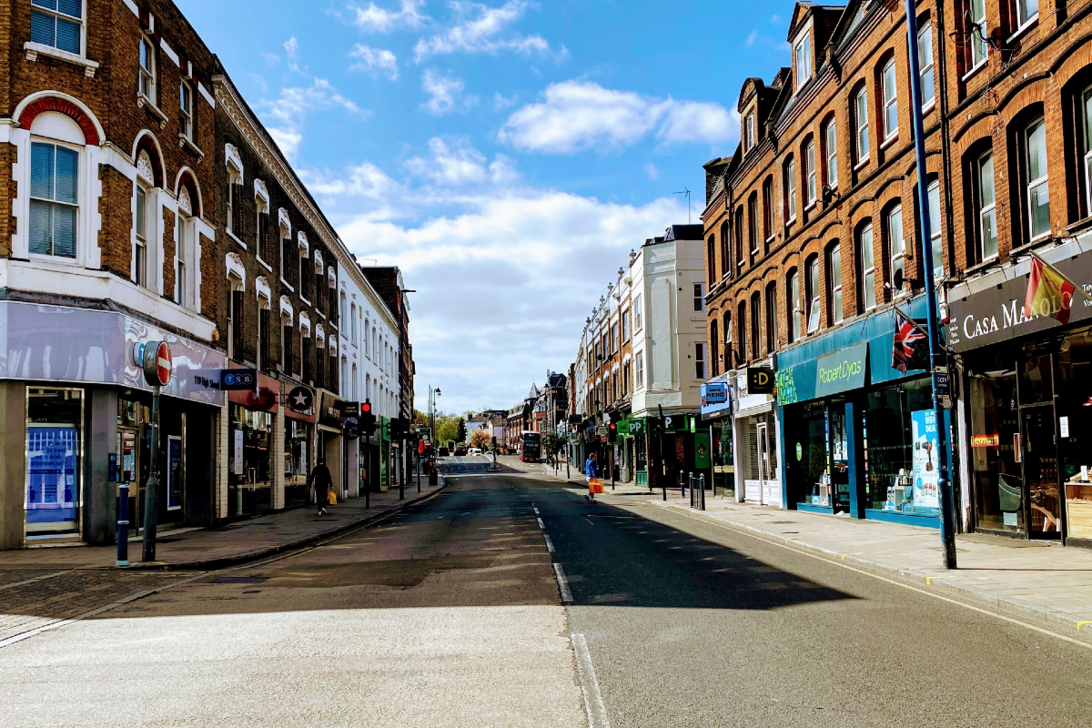 A closed and more or less deserted Putney HIgh Street during the covid health crisis. Photo by John Cameron on Unsplash