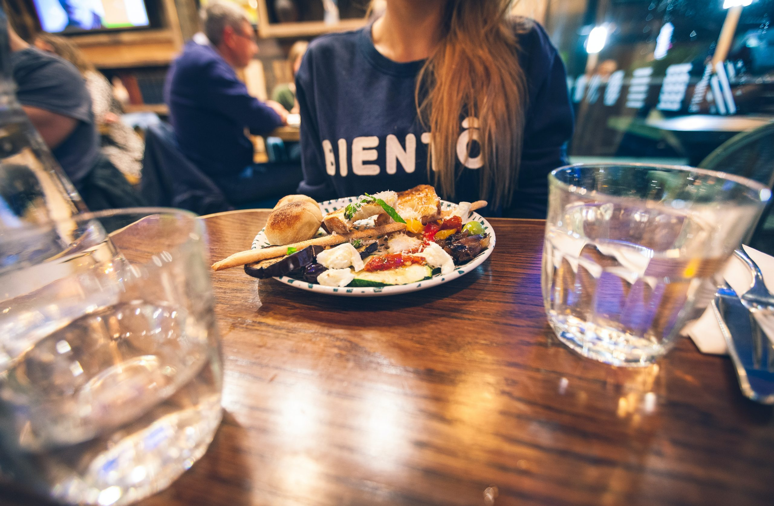 Diner in London. Photo by Artur Tumasjan on Unsplash