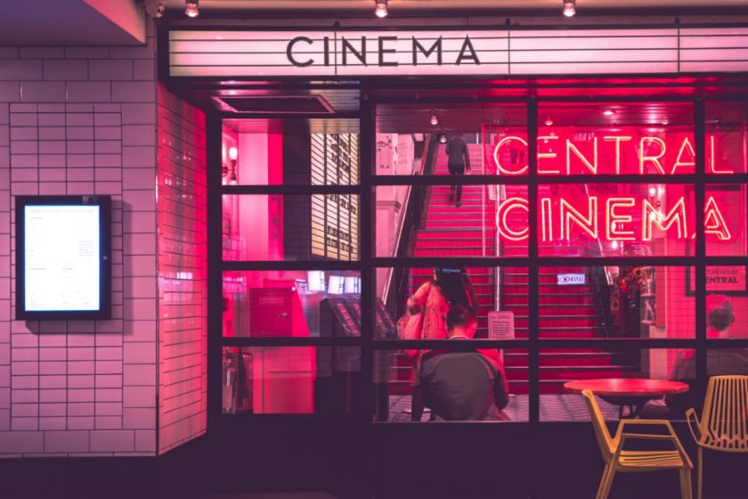 Movie theater with neon signs. Photo by Myke Simon on Unsplash