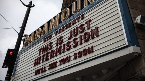 "Paramount cinema billboard: covid-19 ""intermission"". Photo by Nick Bolton on Unsplash"