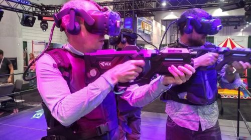 VR gamers with guns. Photo by KWP