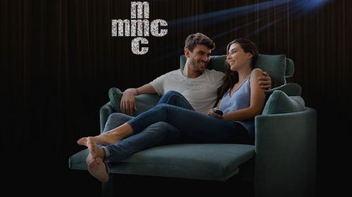 MMC: couple sitting on cinema sofa