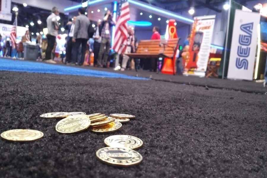 coins in foreground of amusement arcade – KWP