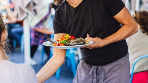 Restaurant waiter– photo by Louis Hansel on Unsplash